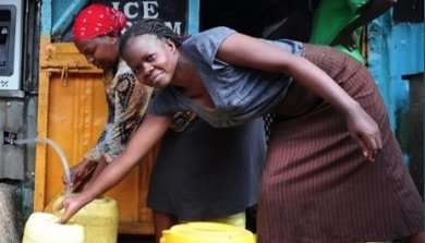 Women filling water containers